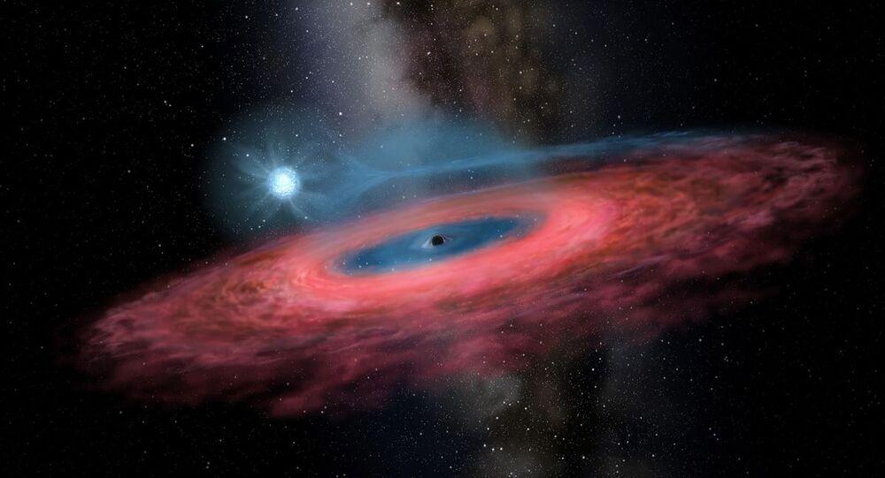 Figura LB-1: Acreção do gás dentro de um buraco negro estelar a partir de sua estrela companheira azul,  através de uma acreção truncada no disco (representação artística)