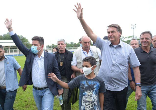 O presidente Jair Bolsonaro visita o município de Sena Madureira, no Acre, para ver a situação das áreas atingidas pela enchente.