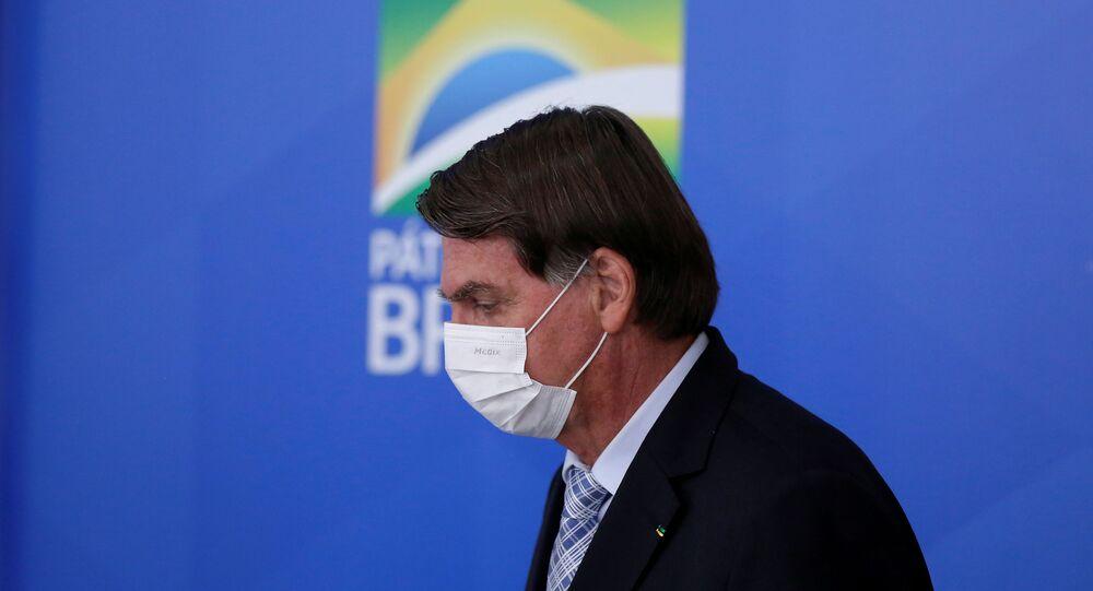 Em Brasília, o presidente brasileiro Jair Bolsonaro (sem partido) participa de coletiva de imprensa no Palácio do Planalto, em 10 de março de 2021