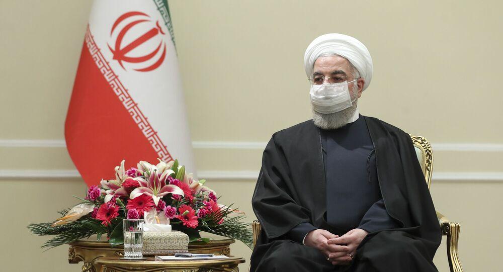O presidente do Irã, Hassan Rouhani, recebe o ministro das Relações Exteriores da Irlanda, Simon Coveney, em Teerã, em 7 de março de 2021