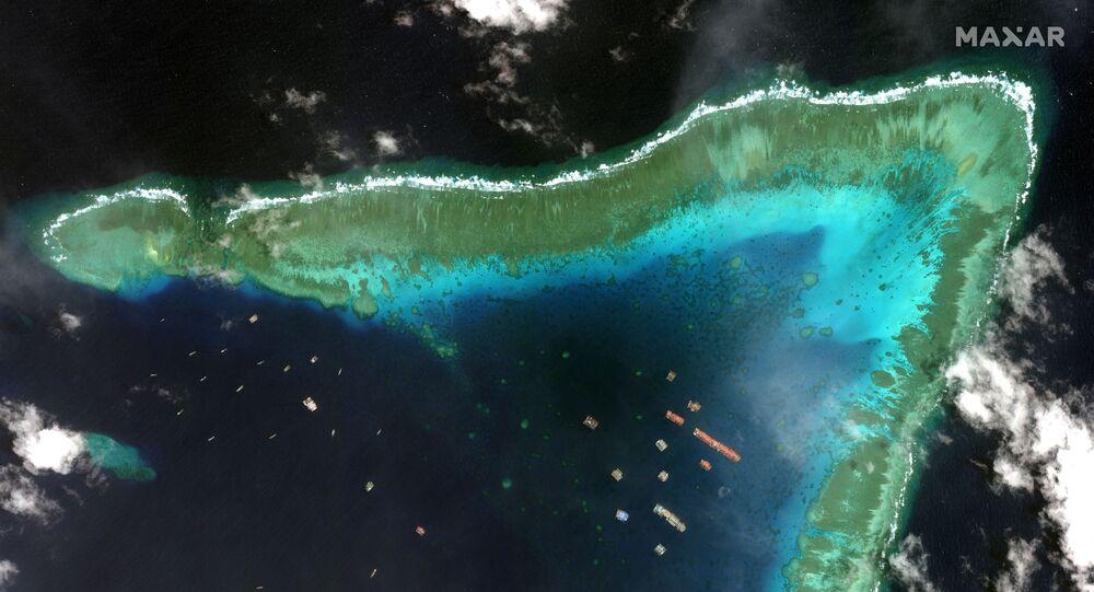 Satélite fotografa navios pesqueiros no recife de Whitsun, 23 de março de 2021
