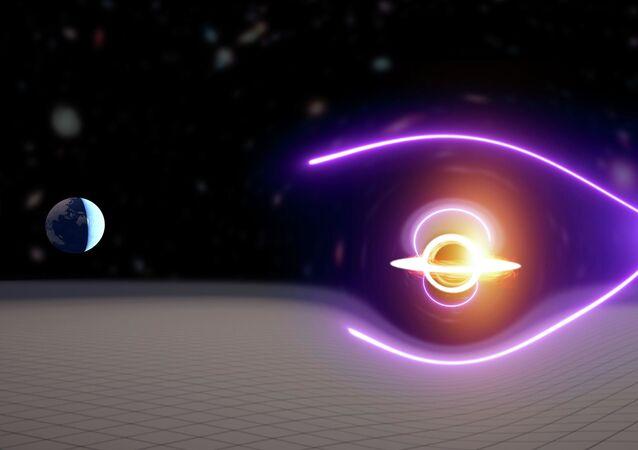 Primeiro buraco negro de massa intermediária foi descoberto através da análise de explosão de raios gama com lentes gravitacionais