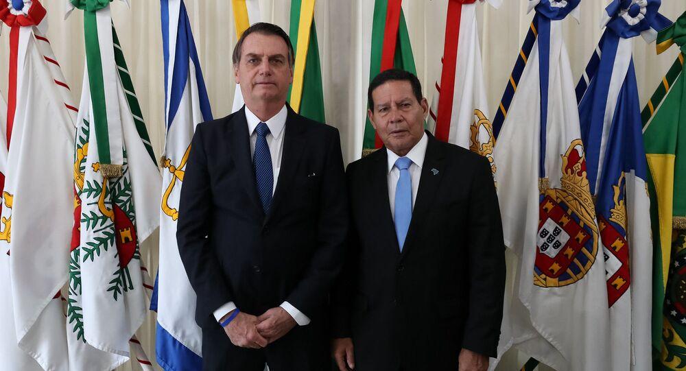 O presidente Jair Bolsonaro durante a transmissão de cargo para o vice-presidente da República, Hamilton Mourão, em 21 de março de 2019