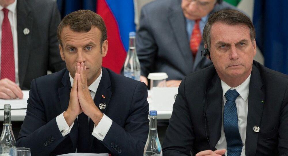 O presidente francês, Emmanuel Macron, ao lado do presidente brasileiro, Jair Bolsonaro, durante cúpula do G20 em 2019, no Japão.
