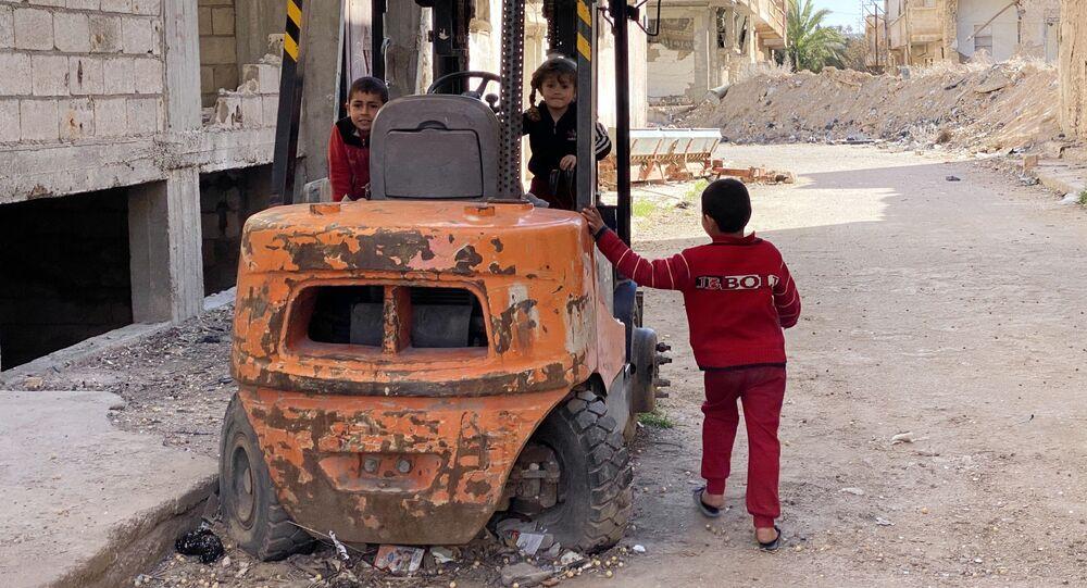 Crianças em uma das ruas de Palmyra, na Síria, em 17 de março de 2021