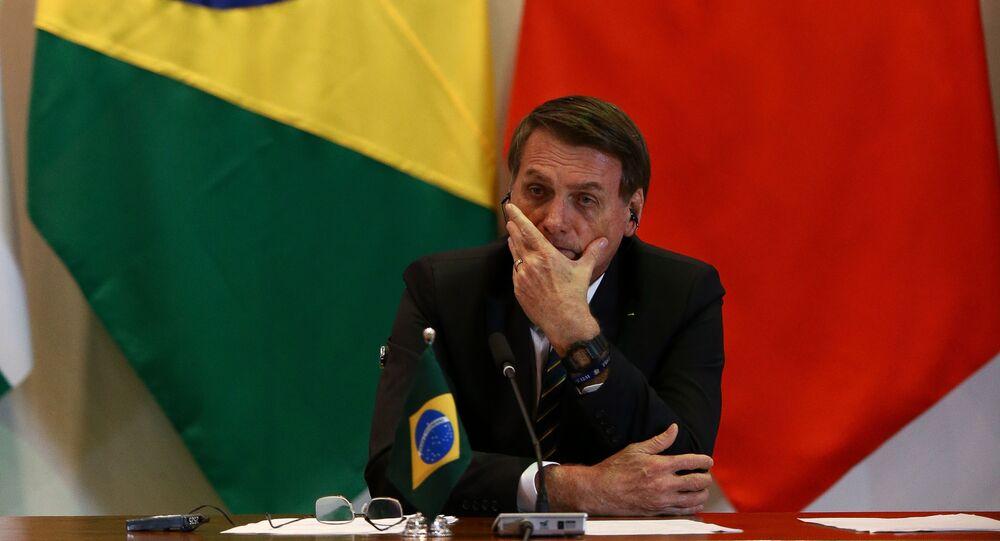 Em Brasília, o presidente brasileiro Jair Bolsonaro, participa de evento do BRICS, em 14 de novembro de 2019