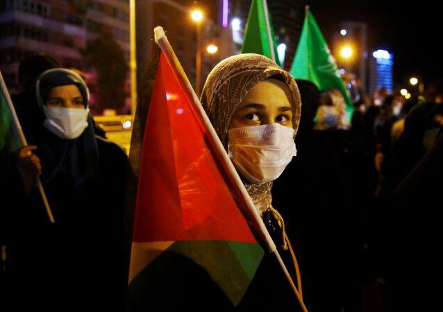 Ativista participa de ato em solidariedade à Palestina em Ancara, Turquia, 10 de maio de 2021