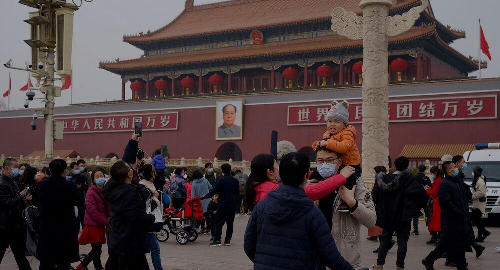Pessoas na Praça da Paz Celestial, em Pequim, no dia 12 de fevereiro de 2021, durante as comemorações do Ano Novo chinês