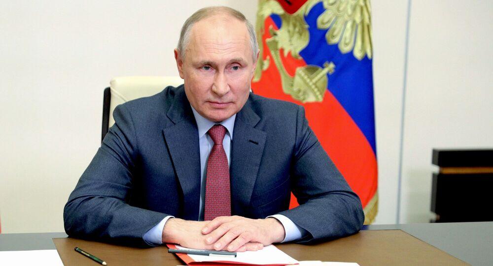 Presidente da Rússia, Vladimir Putin, durante a reunião com os membros permanentes do Conselho de Segurança da Rússia, 14 de maio de 2021