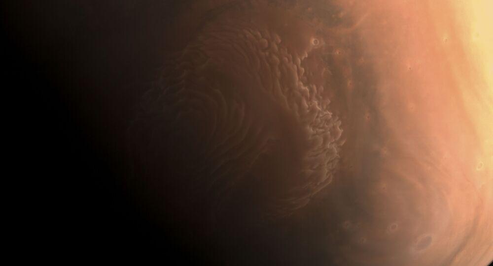 Foto capturada pela sonda chinesa de Marte Tianwen-1, divulgada em 3 de março de 2021, pela Administração Espacial Nacional da China (CNSA, na sigla em inglês) mostra o planeta Marte