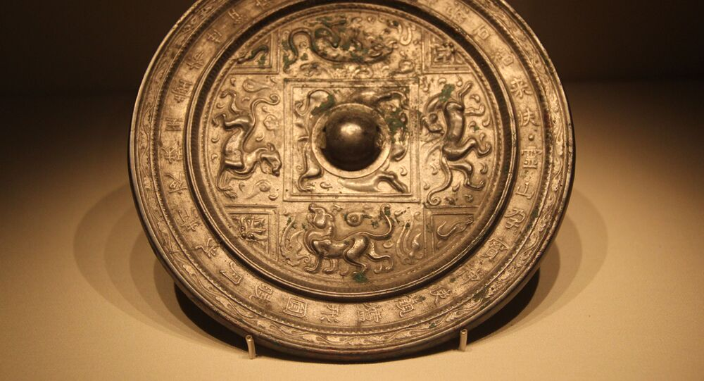 Espelho de bronze chinês