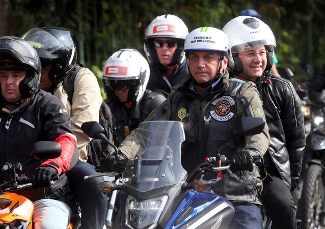 O presidente Jair Bolsonaro participa de ato em São Paulo sem usar máscara em meio à pandemia com mais de 484 mil vítimas do coronavírus, em São Paulo, em 12 de junho de 2021