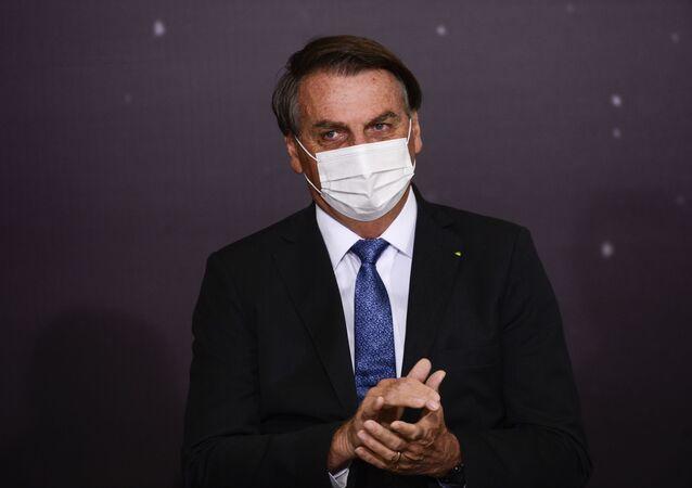 O presidente Jair Bolsonaro durante cerimônia de assinatura de acordo com os EUA para participar do Programa Lunar Nasa Artemis, 15 de junho de 2021