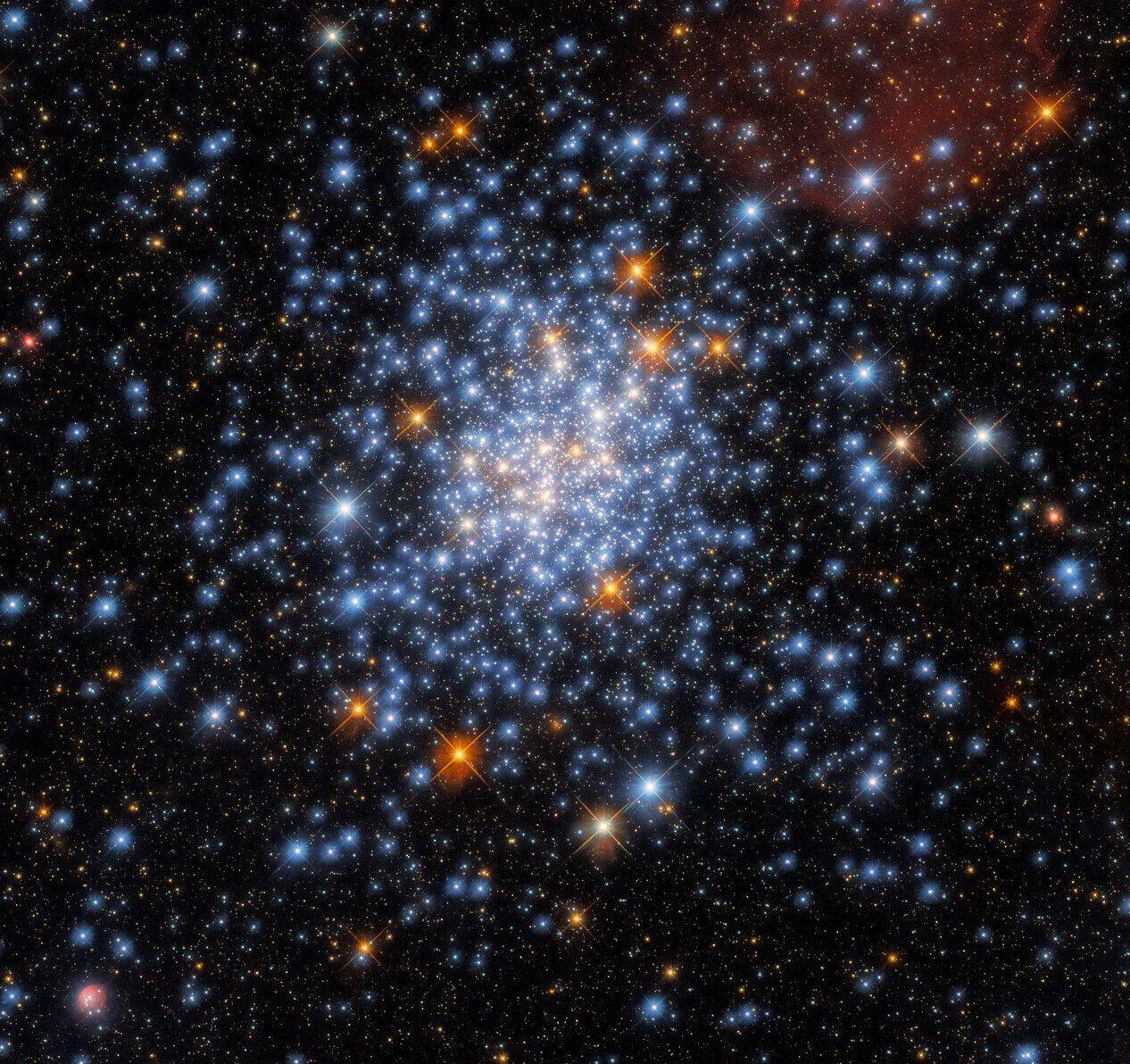Aglomerado estelar NGC 330, localizado a aproximadamente 180.000 anos-luz