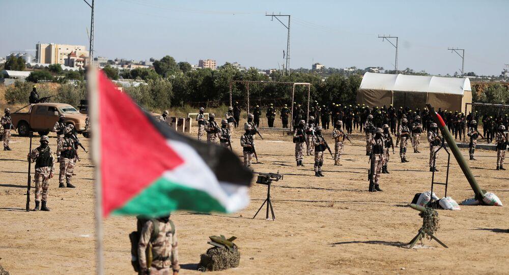 Militantes do movimento Fatah durante um comício contra Israel em Khan Younis, no sul da Faixa de Gaza, 7 de junho de 2021