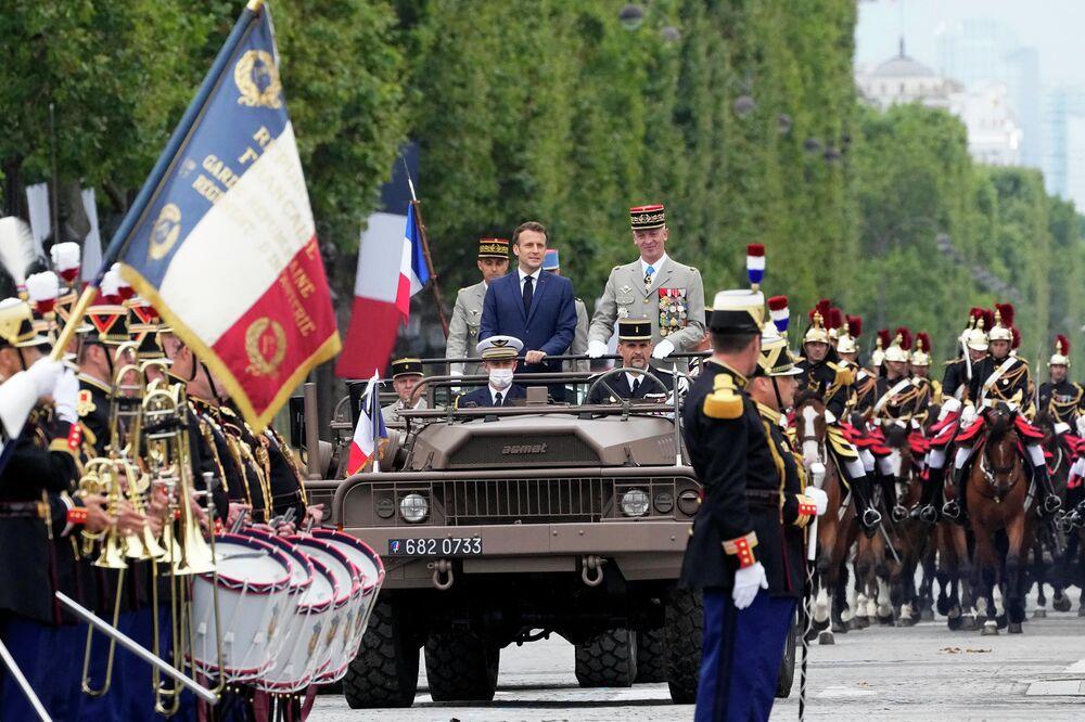Presidente francês Emmanuel Macron e general François Lecointre no desfile do Dia da Bastilha