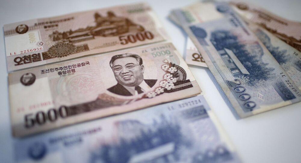 Won norte-coreano com retrato de Kim Il-sung