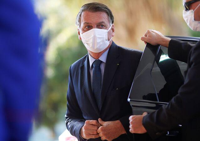 O presidente do Brasil, Jair Bolsonaro, caminha antes de uma cerimônia na sede do Ministério da Defesa em Brasília, Brasil, em 22 de julho de 2021