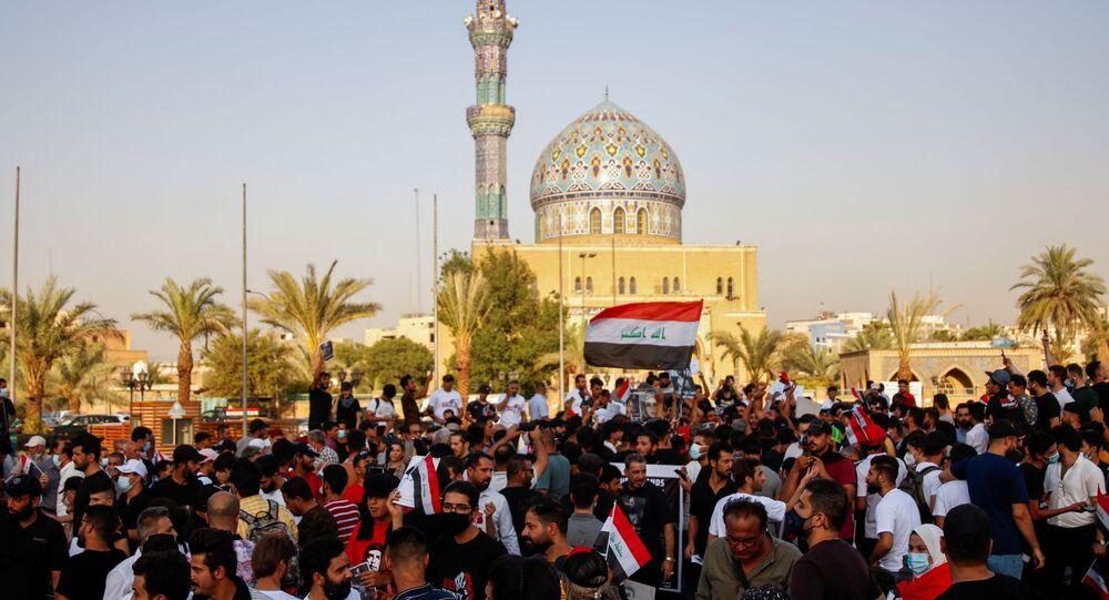 Manifestantes em Bagdá, Iraque, 18 de julho de 2021