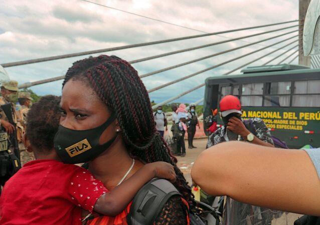 Migrantes na fronteira entre Peru e Brasil, 16 de fevereiro de 2021