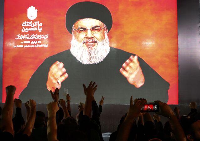 O líder do Hezbollah, Sheik Hassan Nasrallah, fala por meio de um link de vídeo, durante as atividades que comemoram a morte do Imam Hussein, em um subúrbio ao sul de Beirute, no Líbano, 18 de setembro de 2018