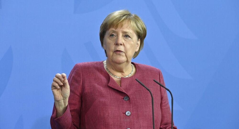 A chanceler alemã, Angela Merkel, dá uma entrevista coletiva após uma cúpula virtual do G7 sobre a crise desencadeada pelo retorno do Talibã ao poder no Afeganistão, na chancelaria em Berlim, 24 de agosto de 2021
