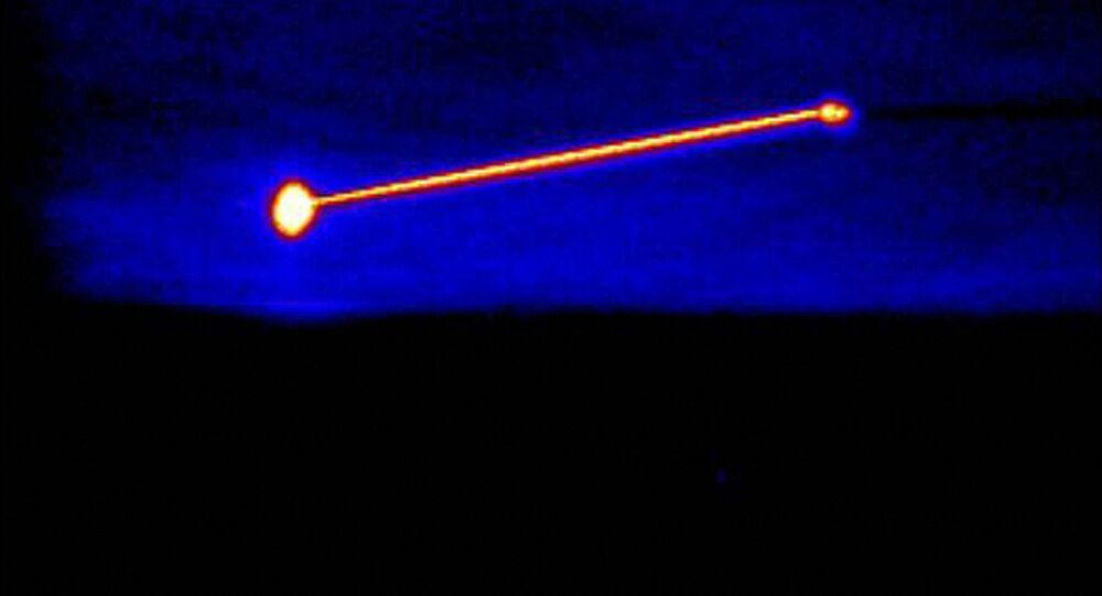 Imagem em infravermelho do Laser Aerotransportado de Teste da Agência de Defesa de Mísseis dos EUA, destruindo um míssil balístico de curto alcance (E). Foto de arquivo