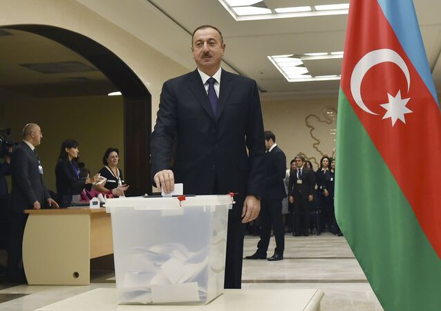 Azerbaijan's President Aliyev casts his ballot at polling station during parliamentary election in Baku