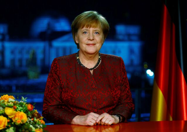 German acting Chancellor Angela Merkel poses for photographs after the television recording of her annual New Year's speech at the Chancellery in Berlin, Germany, December 30, 2017