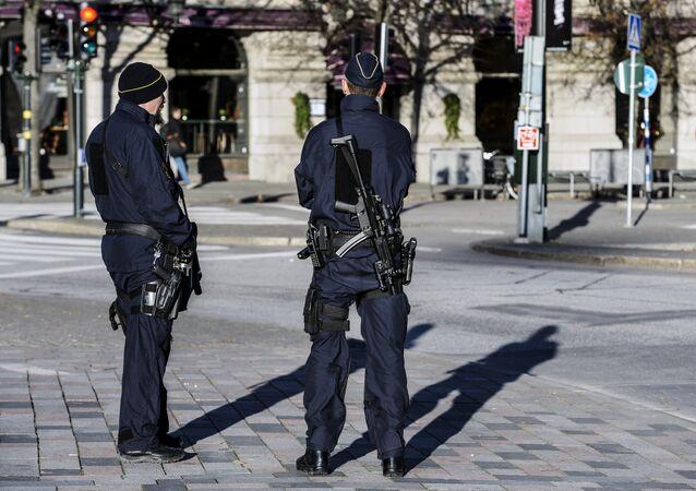 Armed police officers at the Gustaf Adolfs square in central Stockholm, Sweden (file)