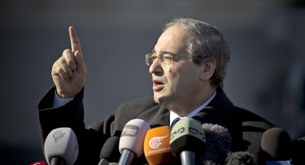 Vice-ministro das Relações Exteriores da Síria, Faisal Mekdad, após um encontro, em Genebra, com representantes da oposição síria (foto de arquivo)
