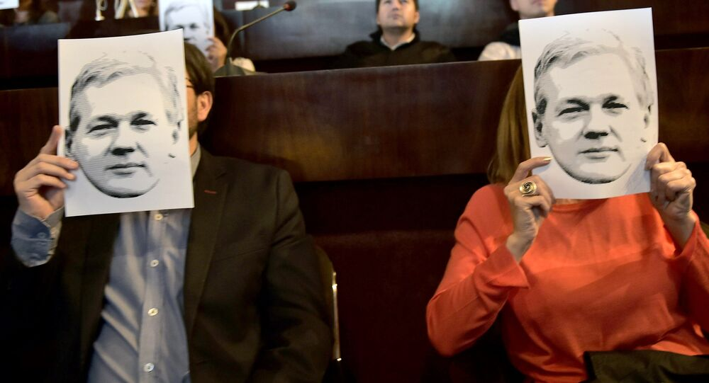 People attend a video conference of WikiLeaks founder Julian Assange at the International Center for Advanced Communication Studies for Latin America (CIESPAL) auditorium in Quito on June 23, 2016.
