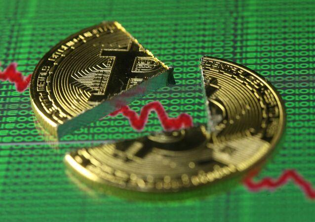 Bitcoin quebrado (imagem referencial)