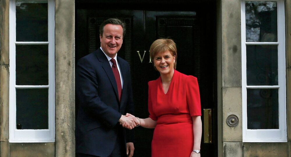 Scotland's First Minister Nicola Sturgeon (R), greets Britain's Prime Minister David Cameron, as he arrives for their meeting in Edinburgh, Scotland, Britain May 15, 2015