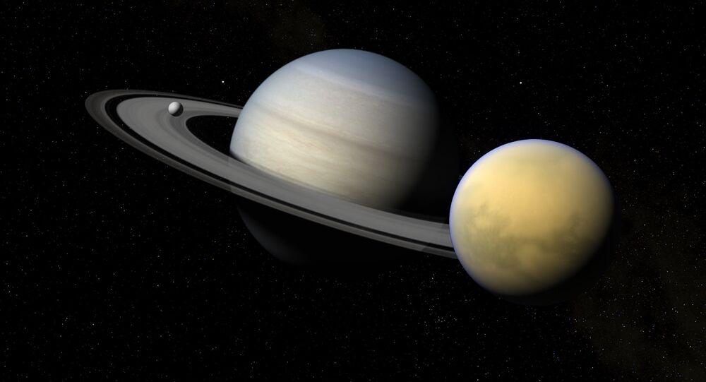Saturno e seus satélites Titã e Encélado