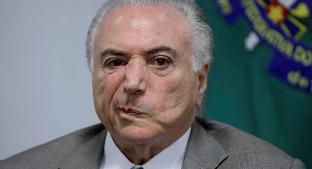 Michel Temer reage a uma réplica durante um encontro sobre a modernização do metrô de Brasília, em 22 de janeiro de 2018