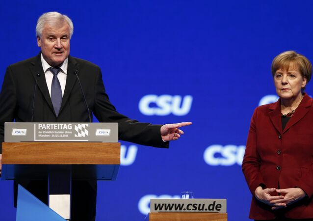 Bavarian Prime Minister and head of the Christian Social Union (CSU) Horst Seehofer welcomes German Chancellor Angela Merkel to the Christian Social Union (CSU) party congress in Munich, Germany in this November 20, 2015.