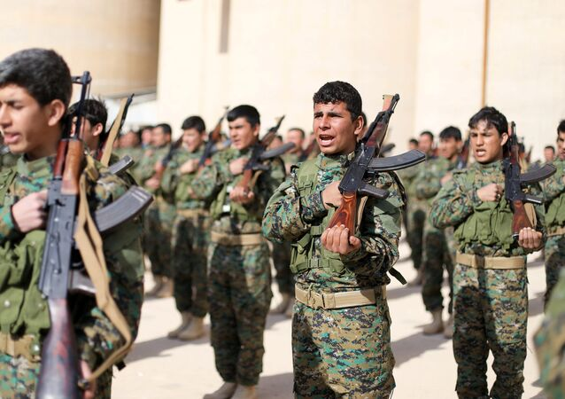 Fighters from a new border security force under the command of Syrian Democratic Forces (SDF) hold their weapons during a graduation ceremony in Hasaka, northeastern Syria, January 20, 2018