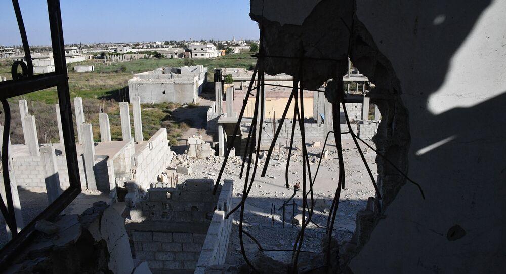 Edifícios destruídos no decurso de operações militares em Ghouta Oriental, nos subúrbios de Damasco.