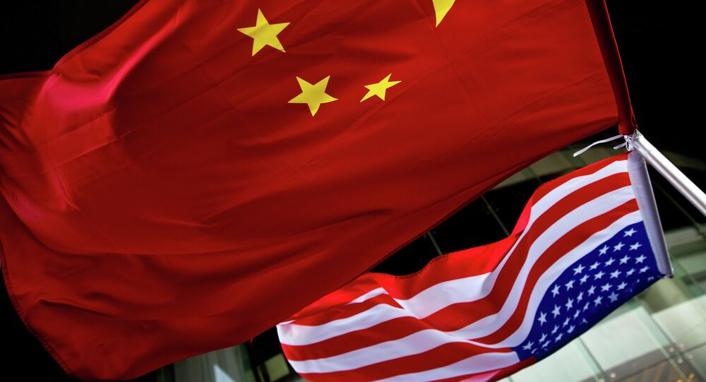 In this Nov. 7, 2012 photo, U.S. and Chinese national flags are hung outside a hotel during the U.S. Presidential election event, organized by the U.S. embassy in Beijing