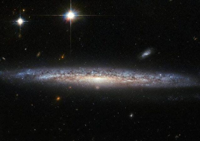 Foto da galáxias NGC 5714 e NGC 1787 tirada pelo Telescópio Hubble da NASA