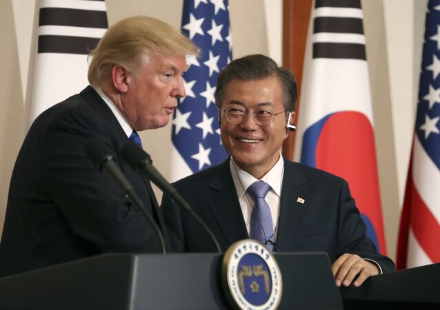 President Donald Trump, left, speaks as South Korean President Moon Jae-in looks on during a joint news conference at the Blue House in Seoul, South Korea, Tuesday, Nov. 7, 2017
