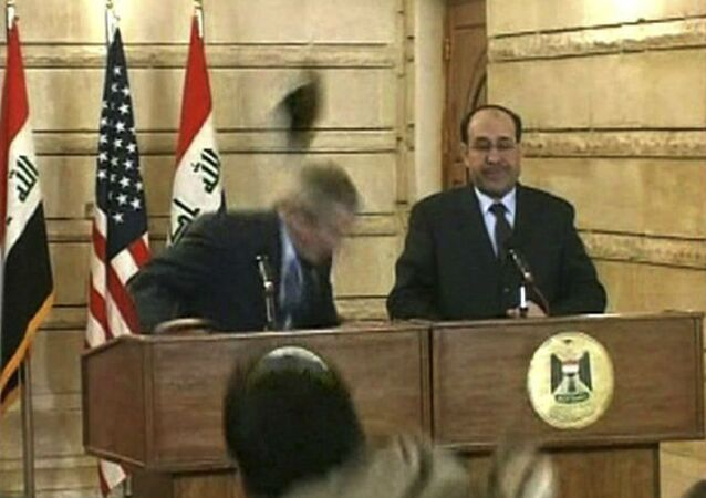 In this image from APTN video, a man throws a shoe at President George W. Bush during a news conference with Iraq Prime Minister Nouri al-Maliki on Sunday, Dec. 14, 2008, in Baghdad. The man threw two shoes at Bush, one after another. Bush ducked both throws, and neither man was hit.