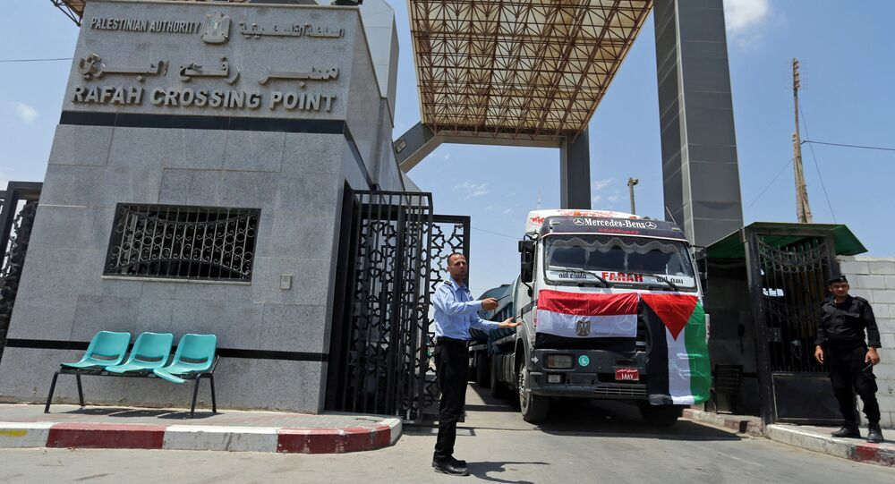 Palestinian policemen loyal to Hamas stand guard as fuel tankers enter Gaza through the Rafah border between Egypt and southern Gaza Strip June 21, 2017.