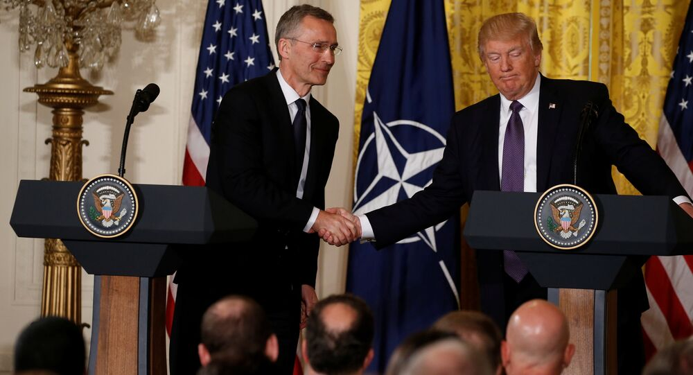 U.S. President Donald Trump (R) and NATO Secretary General Jens Stoltenberg shake hands during a joint news conference in the East Room at the White House in Washington, U.S., April 12, 2017.