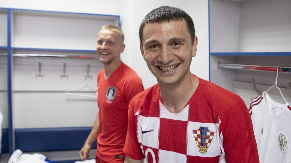Meio-campo Alan Dzagoev (Croácia) e lateral Igor Smolnikov (Coreia do Sul)