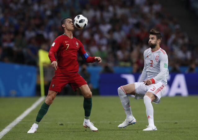 Cristiano Ronaldo e Piqué.