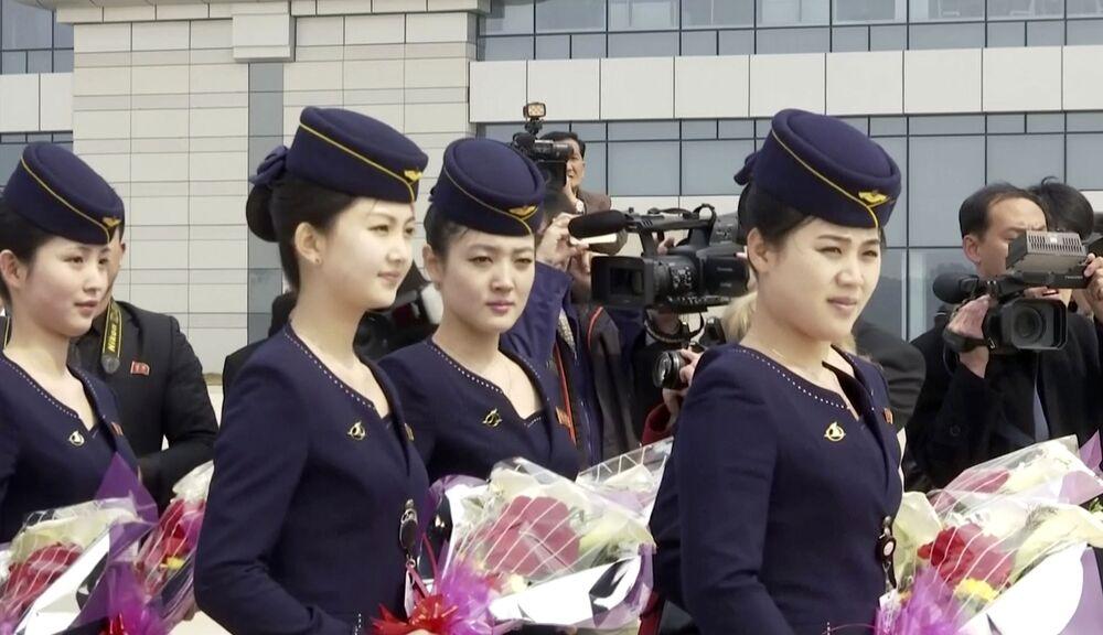 Aeromoças da empresa aérea norte-coreana Air Koryo