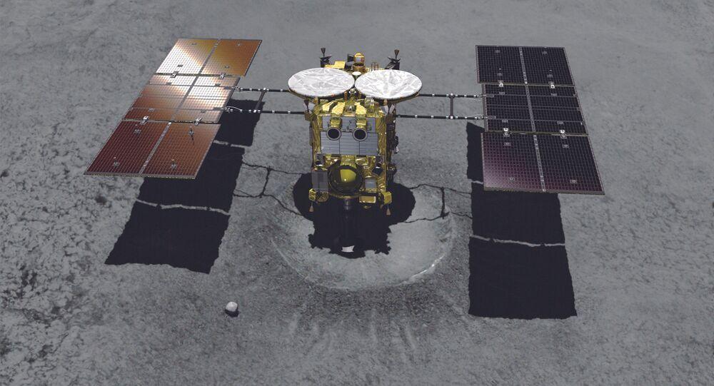 Sonda japonesa Hayabusa-2 se aproximando da cratera do asteroide