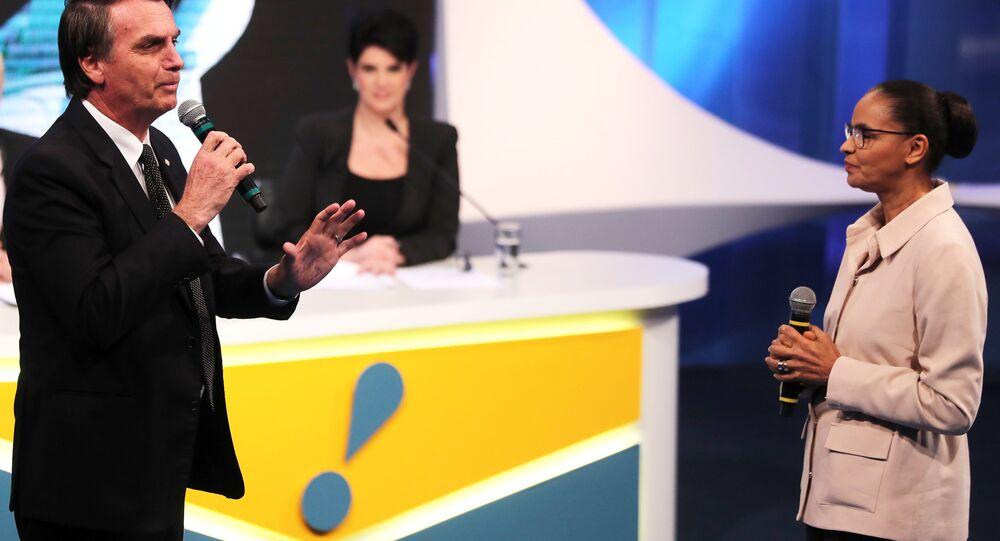 Bolsanaro e Marina durante debate presidencial da RedeTV.